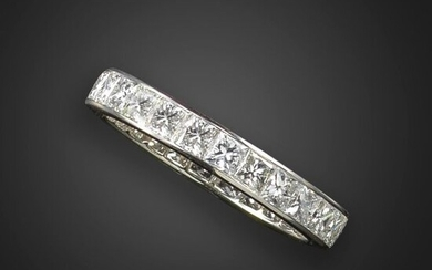 A diamond eternity ring, channel-set with princess-cut diamonds in platinum, approximately 2.50cts total, size N