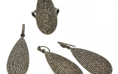A diamond jewellery set comprising a ring, a pair of ear pendants and a pendant each set with numerous single-cut diamonds, mounted in sterling silver.