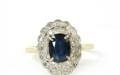 A gold sapphire and diamond cluster ring