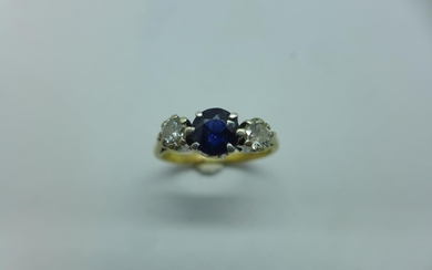 A hallmarked 9ct yellow gold diamond and sapphire ring, size...