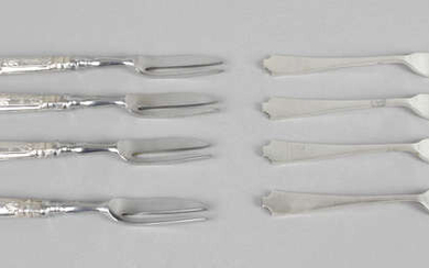 A large assortment of cutlery, comprising teaspoons, cake forks, sugar tongs, etc.