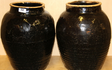 A large pair of early Chinese Honan glazed stoneware vases, H. 38cm, Dia. 28cm.