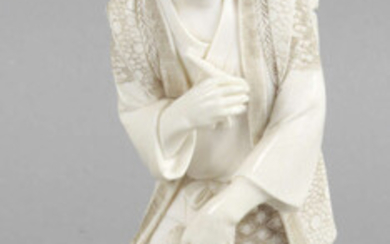 A late 19th century ivory okimono modelled as an elderly gentleman.
