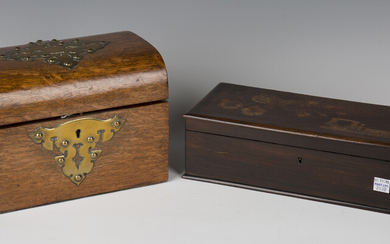 A late Victorian oak and brass mounted dome-topped tea caddy, the interior with twin-lidded compartm