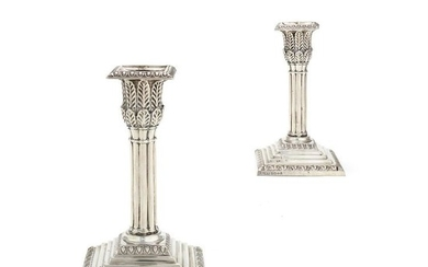 A pair of Victorian silver cluster column candlesticks by Hawksworth, Eyre & Co. Ltd