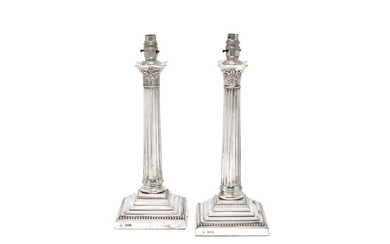 A pair of Victorian silver lamps