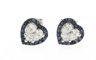 A pair of heart shaped sapphire and diamond ear studs each set with numerous circular-cut sapphires and three diamonds, mounted in 18k white gold. (3)