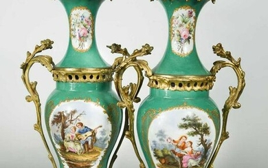 A pair of porcelain and gilt metal mounted two-handled