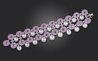 A pink sapphire and diamond bracelet by Scavia, the two rows of pink sapphire clusters set with diamonds and divided by diamond quatrefoils and cultured pearls in white gold, marked, 18cm long
