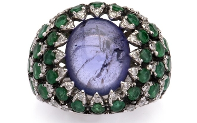 A sapphire and emerald dress ring