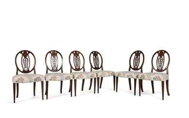A set of six George III mahogany and upholstered dining chairs