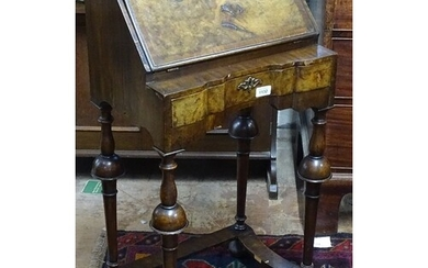 A small crossbanded walnut Queen Anne style bureau, with fit...