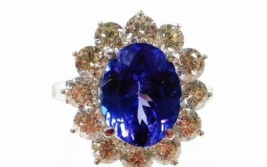 A tanzanite and diamond cluster ring, with oval cut...