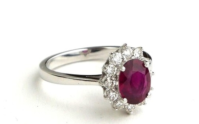 AN 18CT WHITE GOLD, OVAL CUT RUBY AND DIAMOND RING (SIZE N/O...