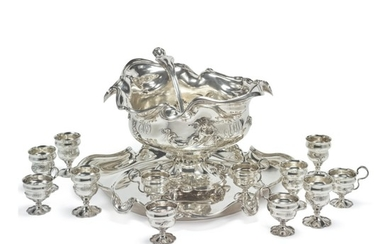 AN AMERICAN SILVER ART NOUVEAU PUNCH BOWL, STAND, LADLE, AND TWELVE CUPS, INTERNATIONAL SILVER CO., MERIDEN, CT, DATED 1909
