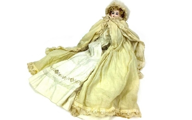 AN EARLY 20TH CENTURY GERMAN BISQUE HEADED DOLL