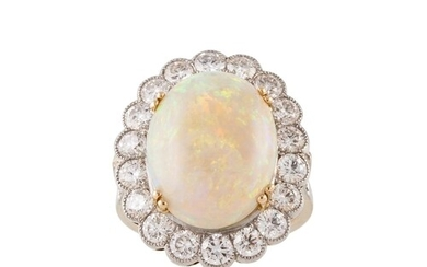 AN OPAL AND DIAMOND CLUSTER RING, the cabachon opal to a bri...