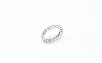 American wedding band in 18k (750) white gold set with diamonds.