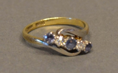 An 18 Carat Gold Sapphire and Diamond Crossover Ring set wit...