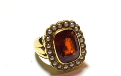 An 18 carat gold hessonite garnet and seed pearl cluster...