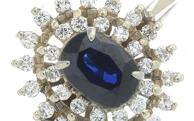 An 18ct gold sapphire and diamond cluster