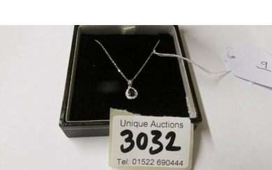 An 18ct white gold pear shaped sapphire and diamond pendant ...