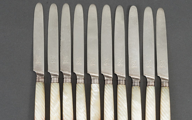An English set of ten early 19th century silver and mother of pearl chees /fruit knifes.