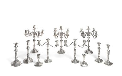 An assembled group of American and Italian weighted sterling silver candlesticks and candelabras