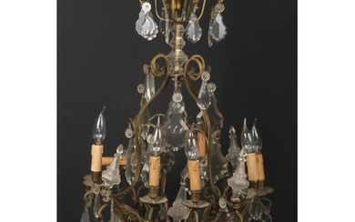 An early-mid 20th century French gilt metal and cut crystal ...