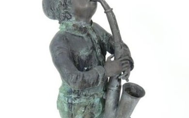 "Cast Iron ""Boy Playing Saxophone"" Garden Sculpture"