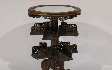 China or Indochina. Wooden pedestal table carved and openwork with...