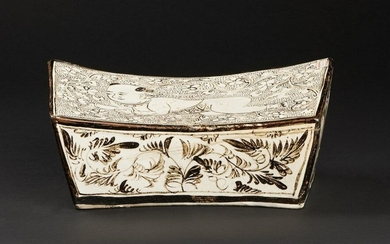 Chinese Art. A cizhou pottery headrest decorated with a child admist leaves and flower China, Ming dynasty or later . Provenance: Private Collection Milan. Cm 39,00 x 14,00 x 18,00.