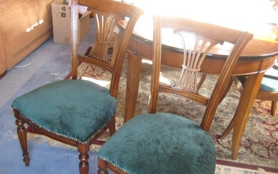 Dining room furniture in stained wood in the...