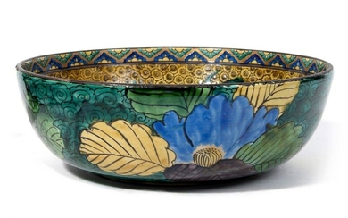 Large Kutani bowl, inside decorated with two shishi lions playing on a background of Japanese apricot blossoms; the outside decorated with peonies on a background of green clouds. Mark underneath : Fuku. In a box. Meiji period.