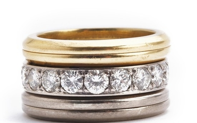 Magnus Enna: An eternity ring with diamonds weighing a total of app. 2.00 ct., mounted in 18k white gold and four side rings of 18k gold and white gold. (5)