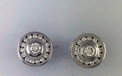 Pair of earrings in 750°/°° white gold set with a brilliant cut diamond in a diamond setting, weight: 5,87g