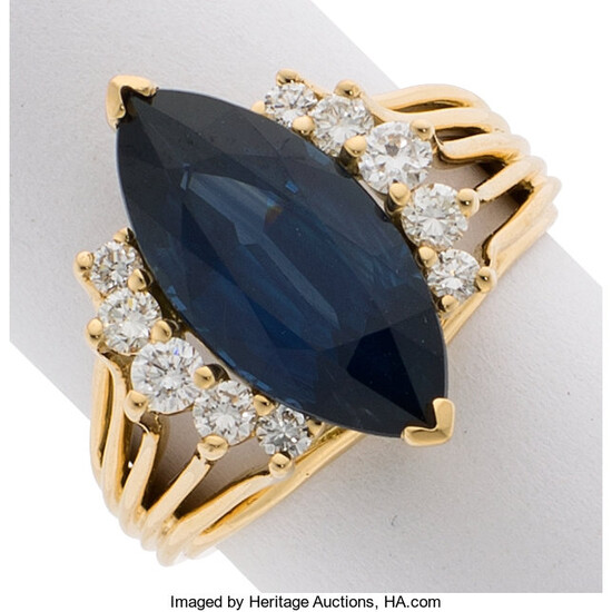 Sapphire, Diamond, Gold Ring The ring features a marquise-shaped...