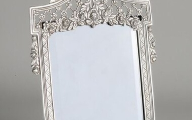 Silver photo frame, 800/000. Contoured rectangular openwork photo frame richly decorated with flowers. Awarded a bow. 18x29cm. Equipped with velor back. In very good condition
