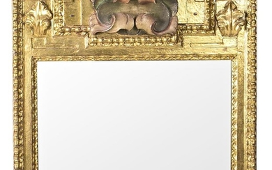 Spanish mirror with frame in carved, painted and gilt wood, made with altarpiece fragments, 17th Century.