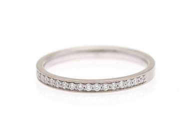 Stenstrup: A diamond eternity ring set with numerous diamonds weighing a total of app. 0.16 ct., mounted in 18k white gold. F/VS. Size 55.5.