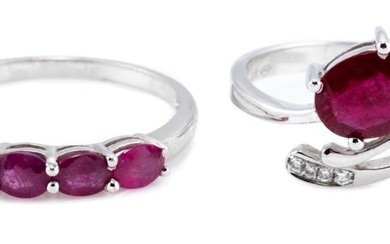 TWO WHITE GOLD RUBY RINGS; an 18ct with oval cut ruby and four small round brilliant cut diamonds, size M, wt. 2.06g, other 14ct set...