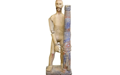 A 19TH CENTURY CARVED WOOD AND POLYCHROME DECORATED FIGURE OF CHRIST SCOURGED