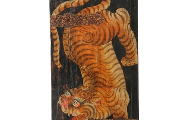 A 20th century Tibetan door decorated with a tiger, canvas mounted on wood. H. 153 cm. W. 80 cm