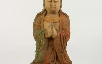 A CARVED WOOD FIGURE. 2ft high.