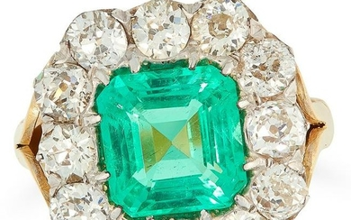 A COLOMBIAN EMERALD AND DIAMOND CLUSTER RING set with
