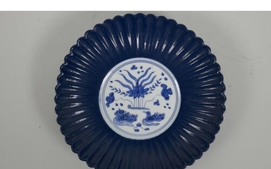 A Chinese blue and white porcelain Ming style ribbed dish wi...