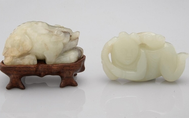 A Chinese celadon and russet jade 'Boy and fungus' carving
