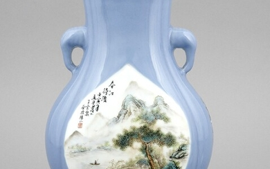 A Chinese vase, late Qing /early republic period, porcelain, polychrome onglaze painting, flattened pear shape on a high stand, 2 stylized elephant-head handles, the light blue background with landscape painting, inscription in black, iron-red seals...