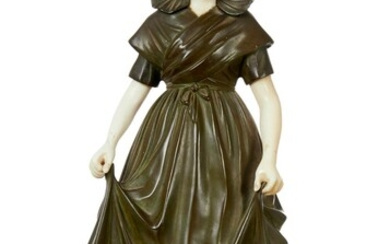 A FRENCH BRONZE AND IVORY FIGURE OF A BRETON GIRL