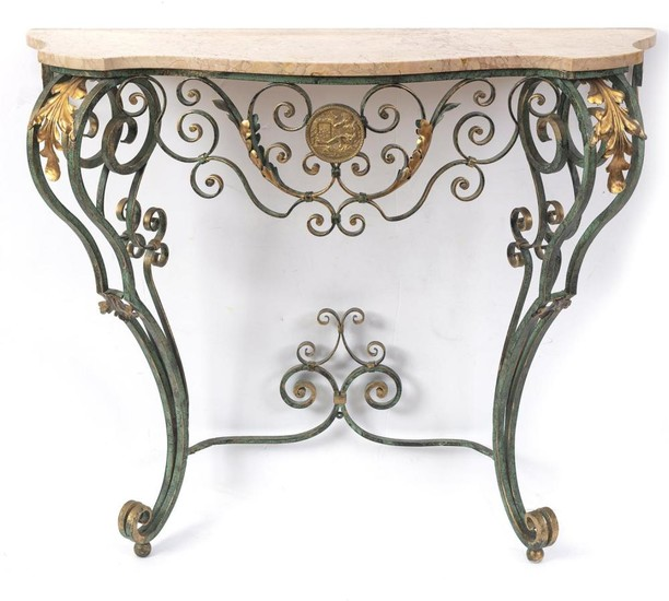 A FRENCH WROUGHT IRON CONSOLE TABLE OF SERPENTINE FORM, THE BASE PAINTED GREEN WITH GILDED HIGHLIGHTS AND APPLIED WITH A BRASS PLAQU...